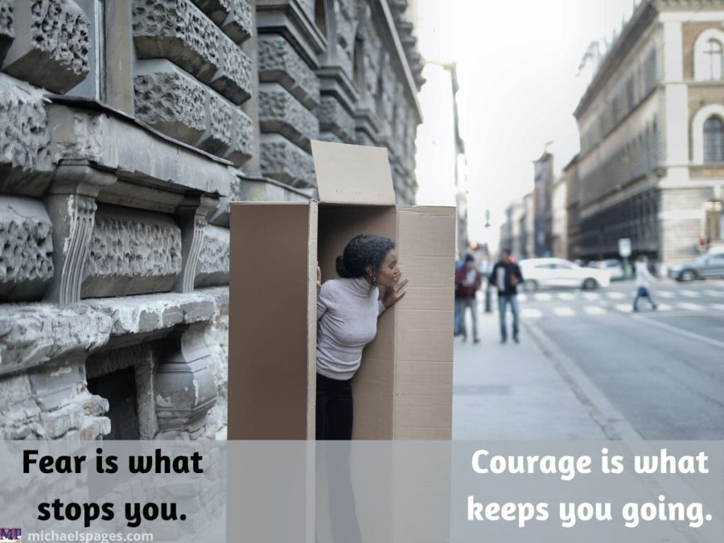 Woman is starting getting out of box and quote about fear and courage
